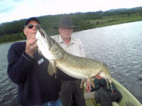 A 34lb Butterstone pike caught on the Fly by Mr Johnstone(the one in the ground)